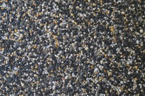 close up of charcoal exposed aggregate concrete